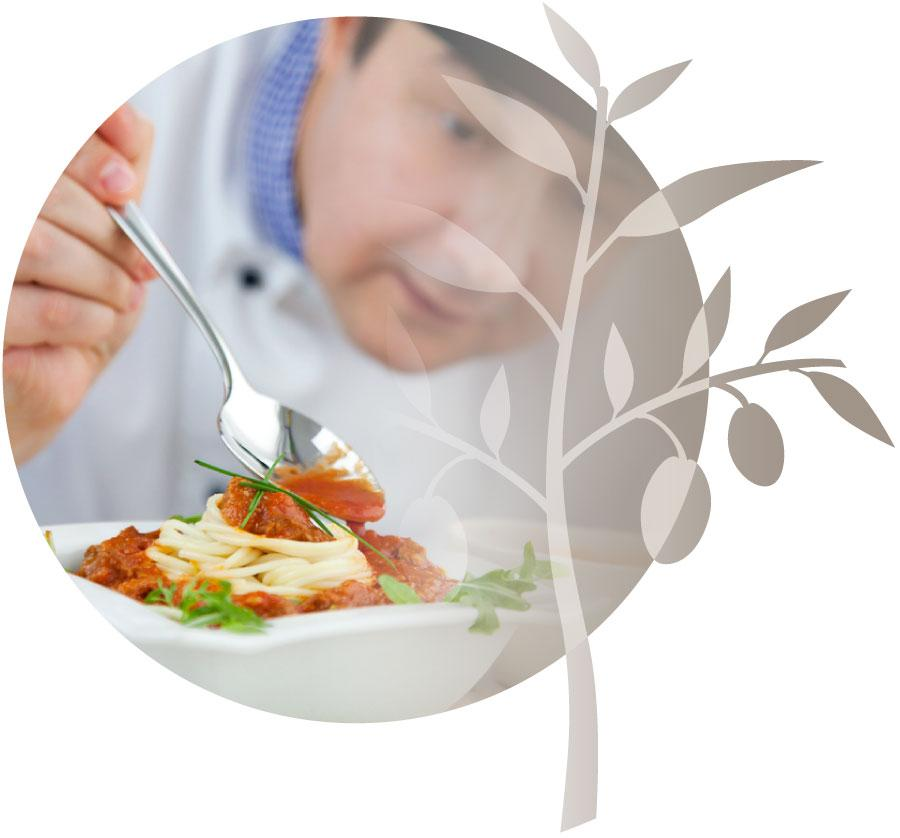 Chef cooking and preparing nutritious meals for residents.